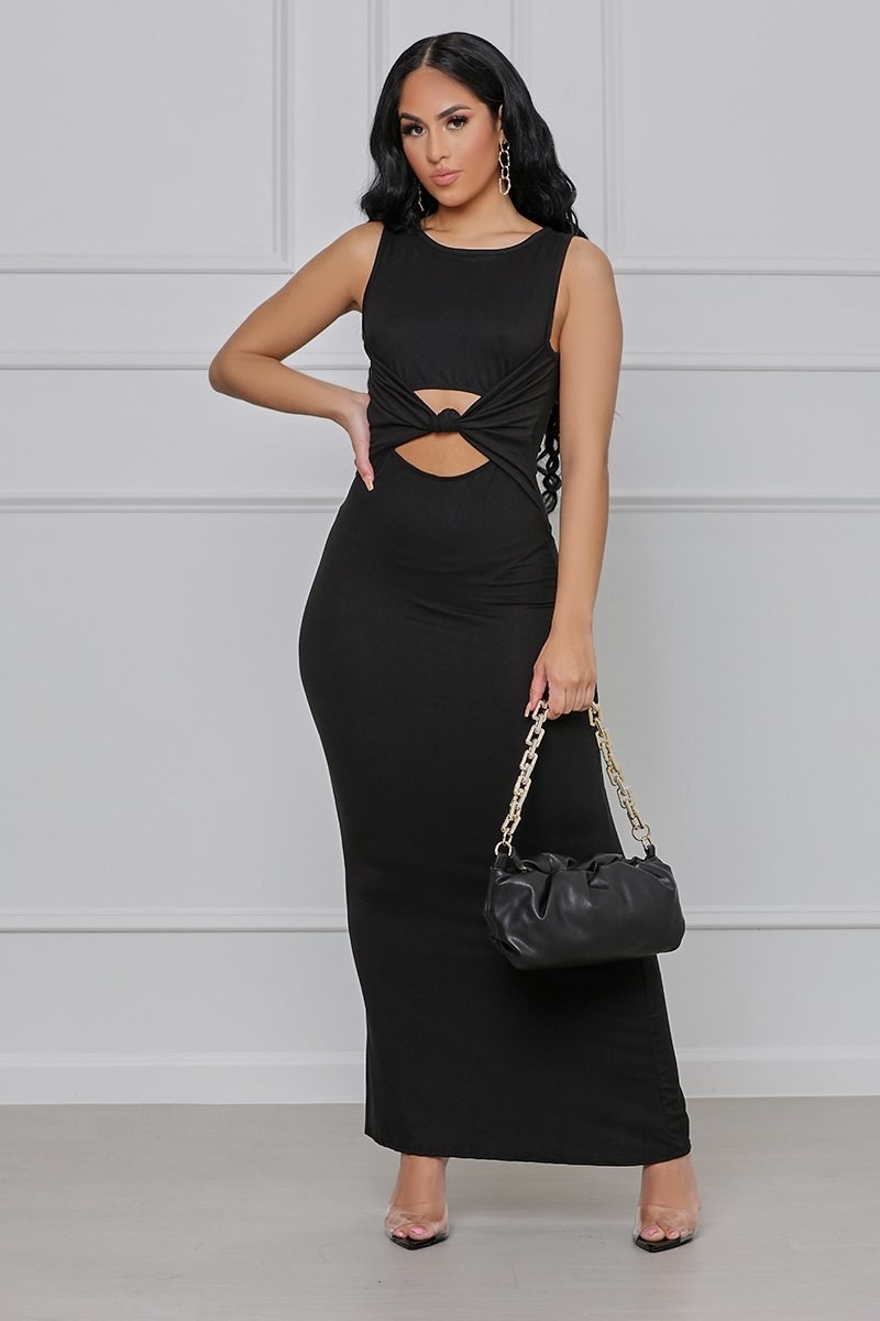 model in ankle length dress with two cutouts in the torso