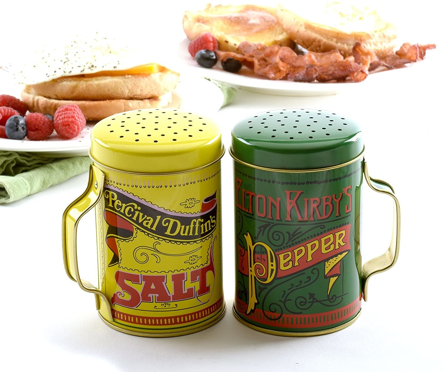 Tin salt and pepper shakers with handles and old school sign designs