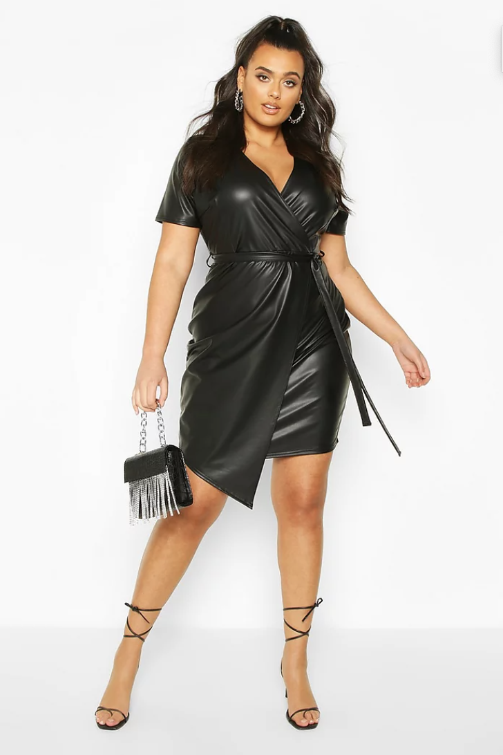 model in black faux leather wrap dress with a tie at the waist