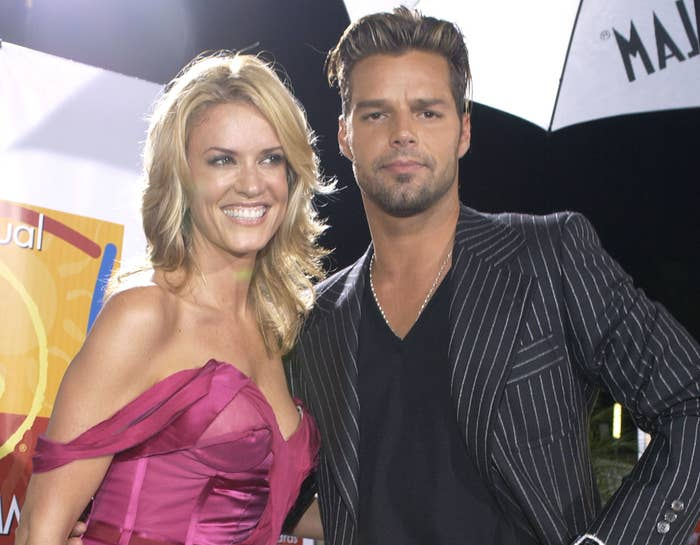 Ricky poses with Rebecca on a red carpet