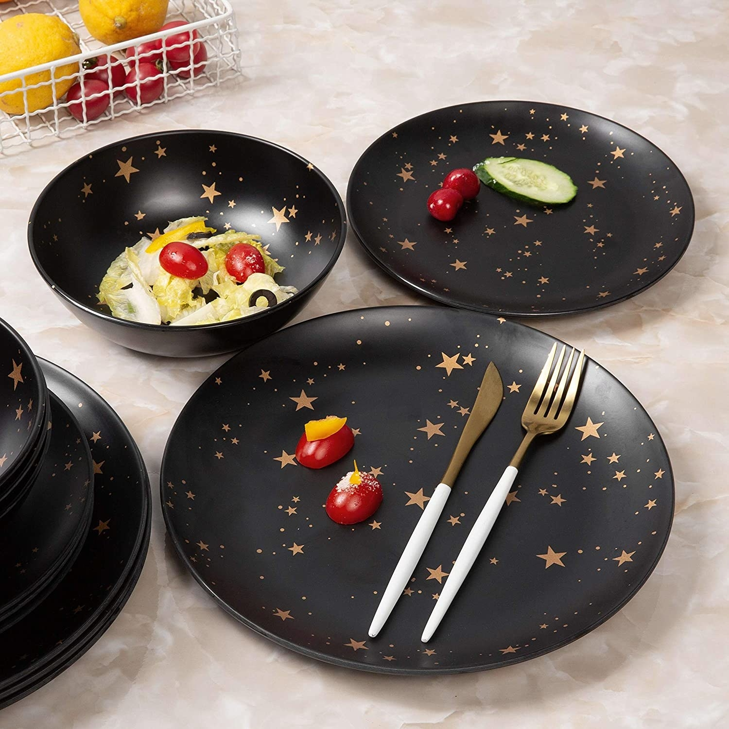 Several matching plates and bowls covered in gold stars