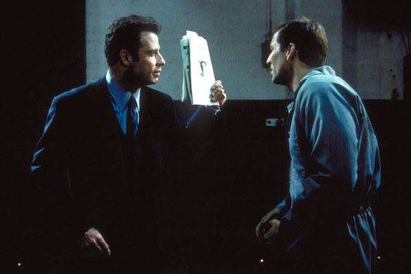 John Travolta and Nicolas Cage facing off.