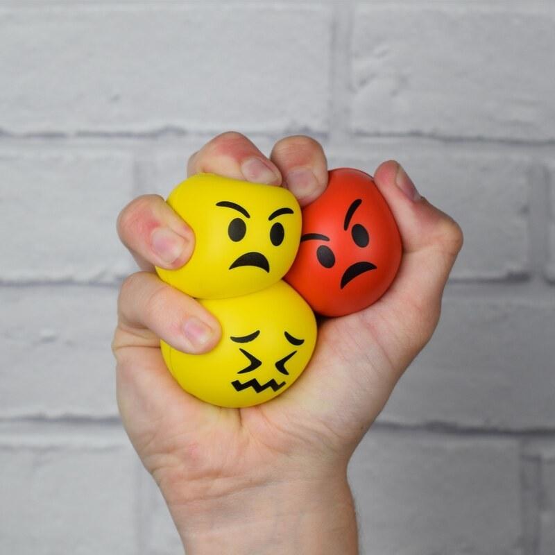 A trio of stress balls designed like emojis