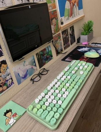 a reviewer photo of their desk set up with the green keyboard and matching mouse