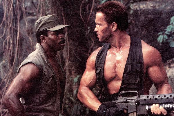 Carl Weathers and Arnold Schwarzenegger getting ready to fight.