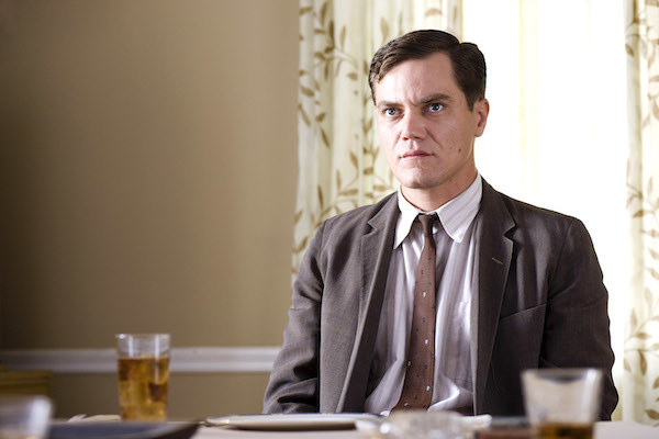 Michael Shannon looking displeased while sitting
