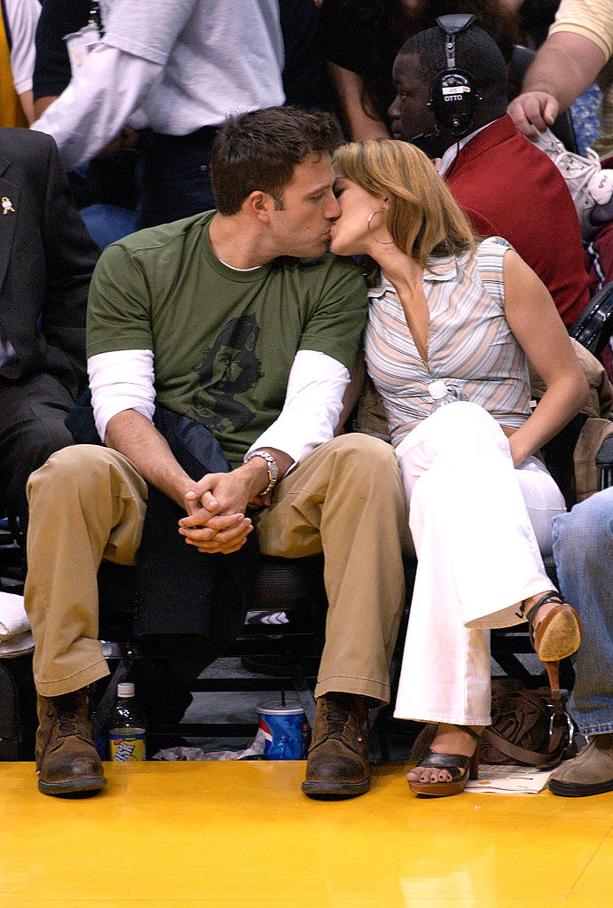Ben Affleck (L) and Jennifer Lopez attend the Los Angeles Lakers v. San Antonio Spurs playoff game