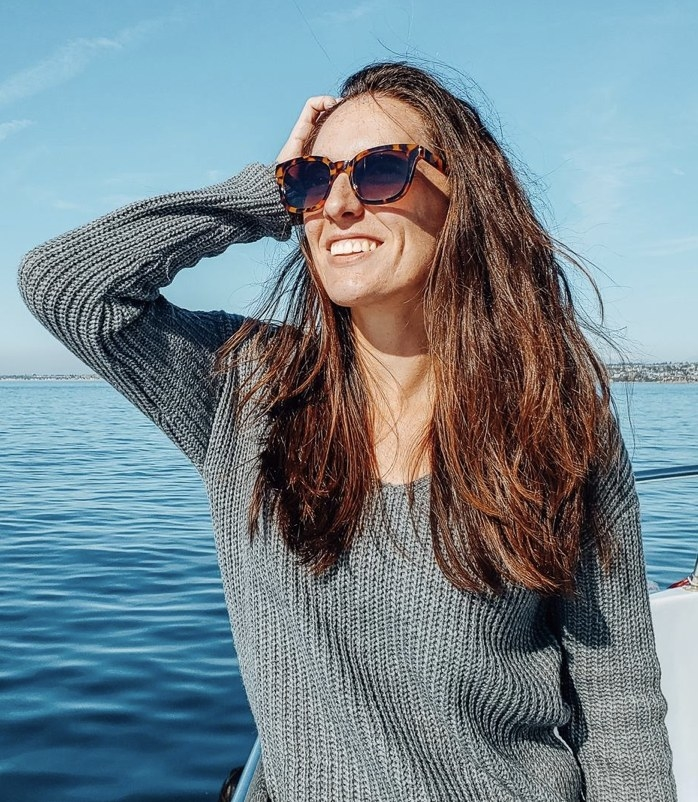 A reviewer wearing a pair of tortoise sunglasses out on a boat