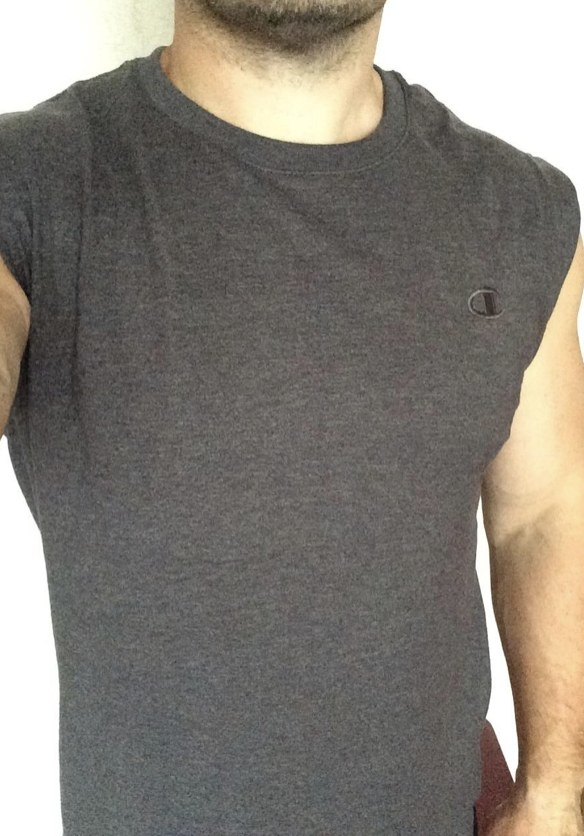 A reviewer wearing a grey muscle tank top