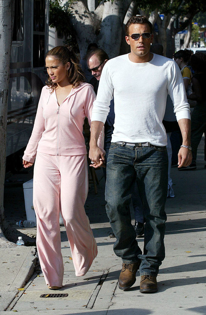 Jennifer Lopez and actor Ben Affleck hold hands while filming her new music video