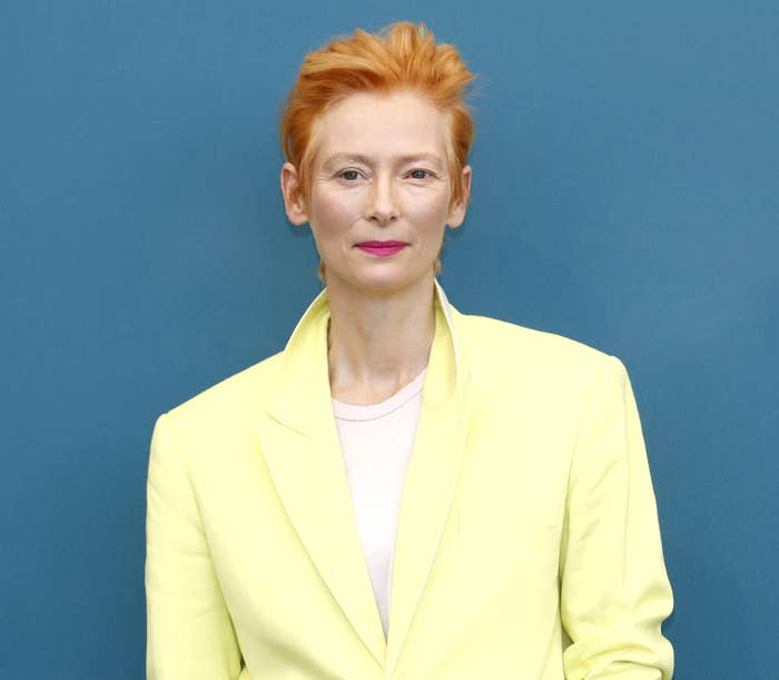 Tilda Swinton in a pale yellow jacket and white T-shirt