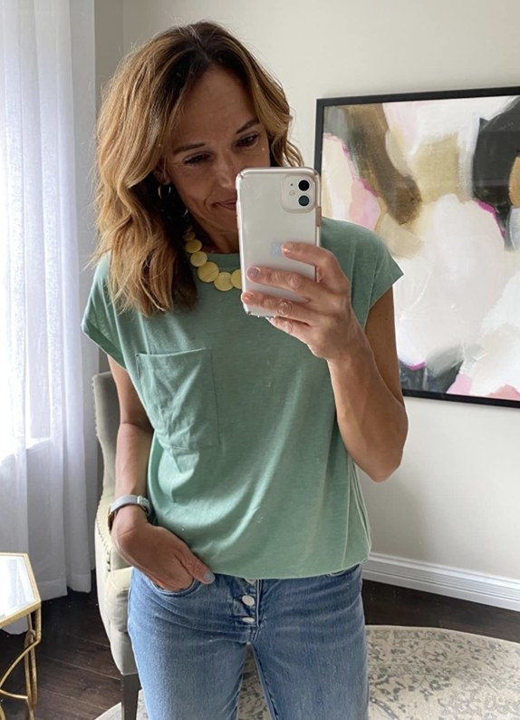 A reviewer wearing a pocket tee