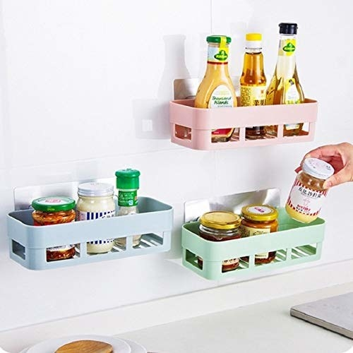 Wall-mounted shelves containing jars with a hand reaching out to grab one