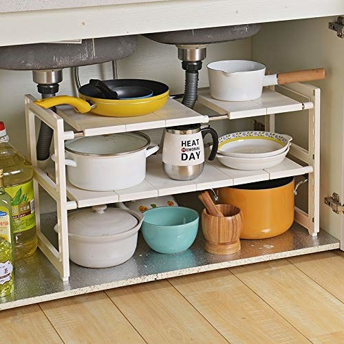 An organiser under the sink with pots and pans on it