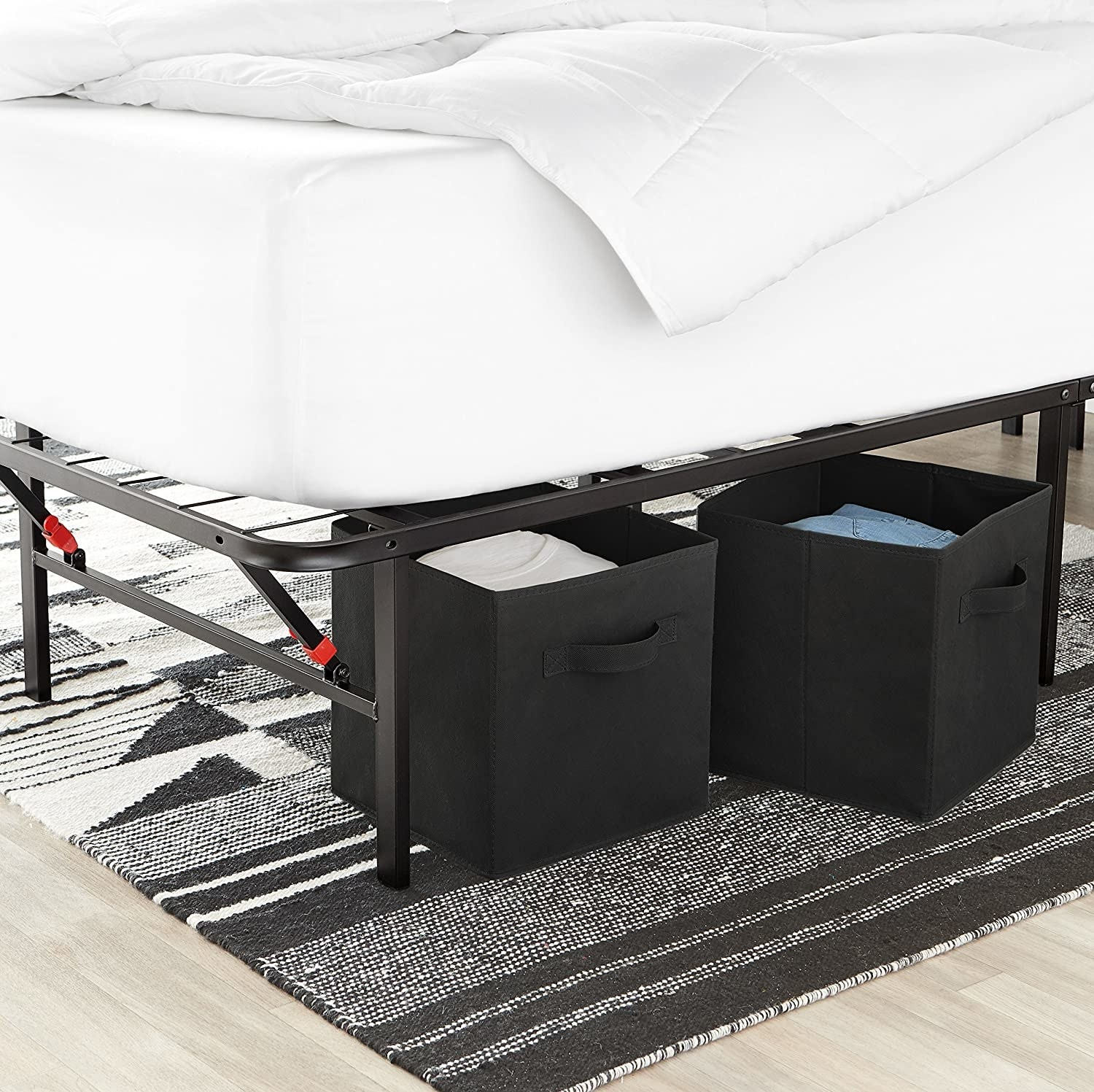 Two storage cubes under a bed