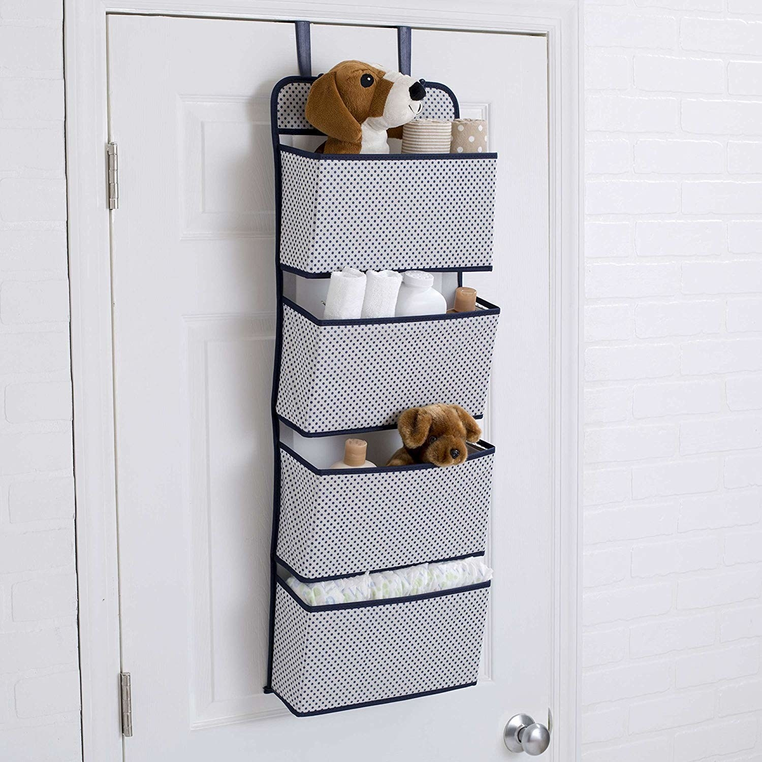 A grey over-the-door organiser with toys in it