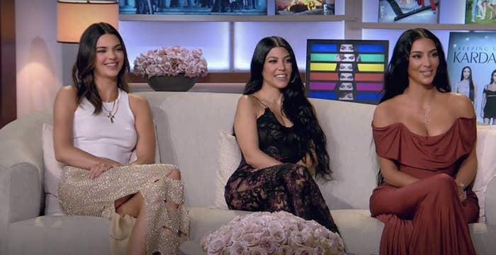 Close-up of Kendall Jenner, Kourtney Kardashian, and Kim Kardashian smiling