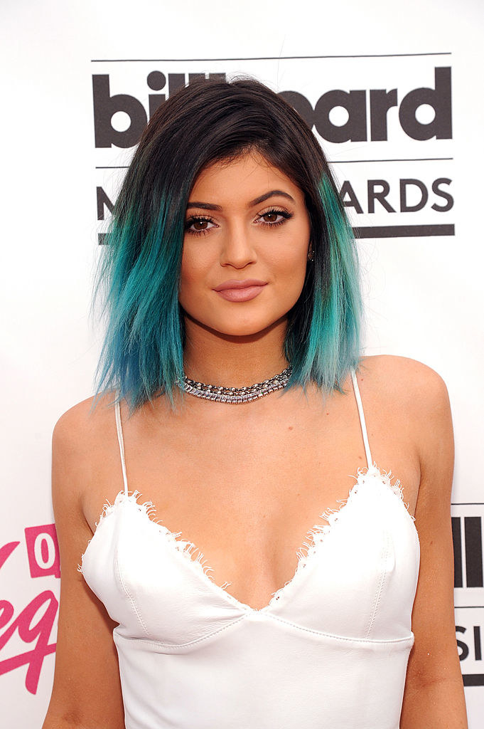 Kylie with two-toned hair and a spaghetti-strap white outfit on the red carpet