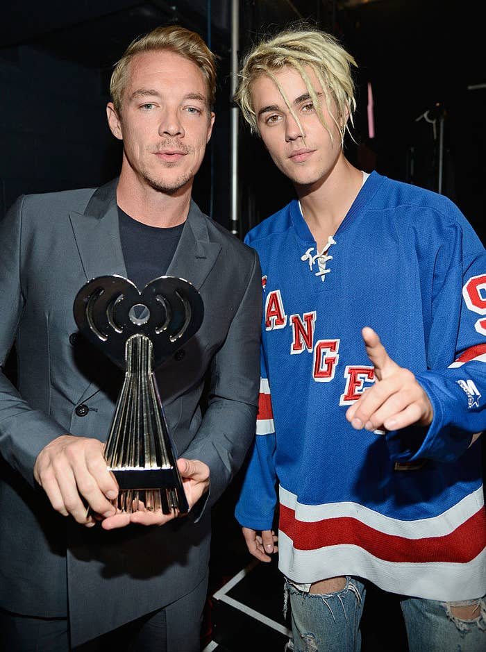 Diplo holding an award and Justin Bieber in a Rangers jersey