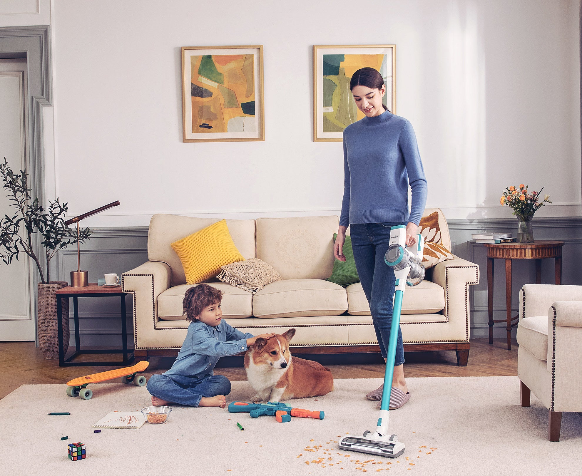 Model using vacuum in home with kid and dog