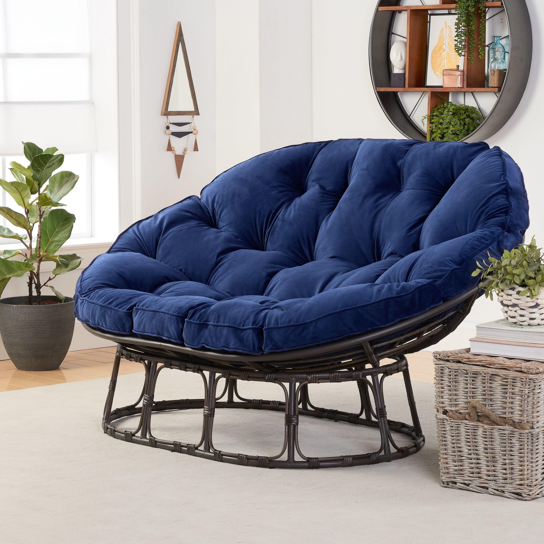 A blue beach chair with dark wood legs