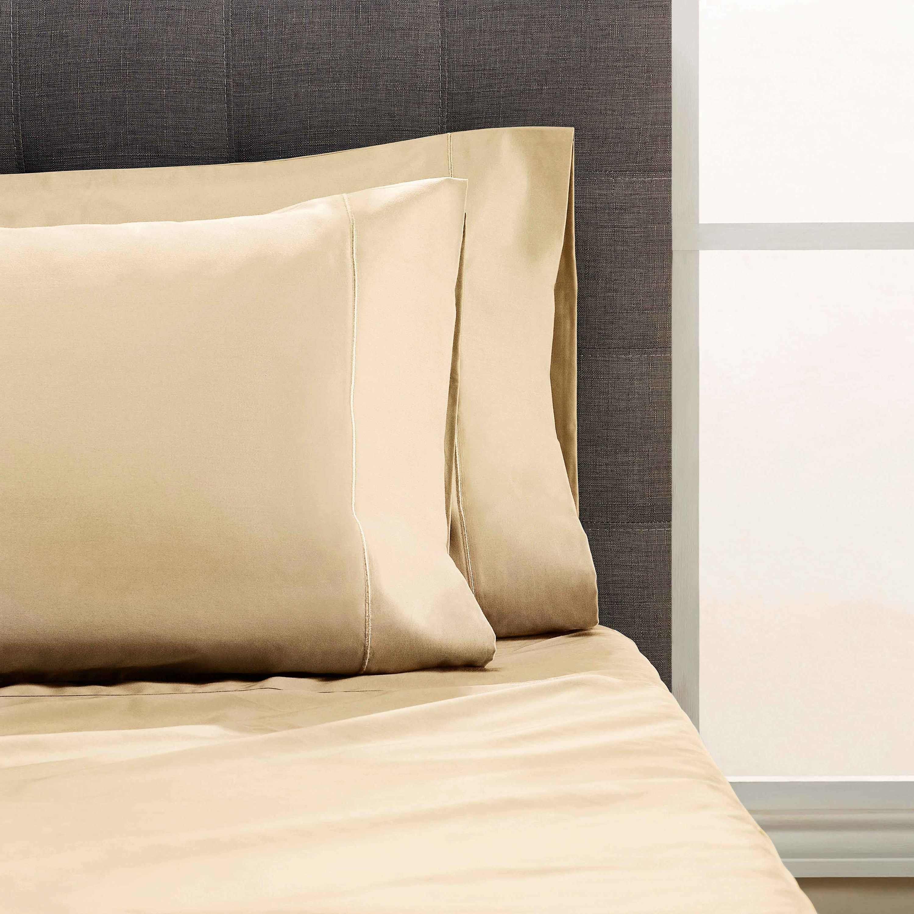 Peach sheets and pillow cases on bed