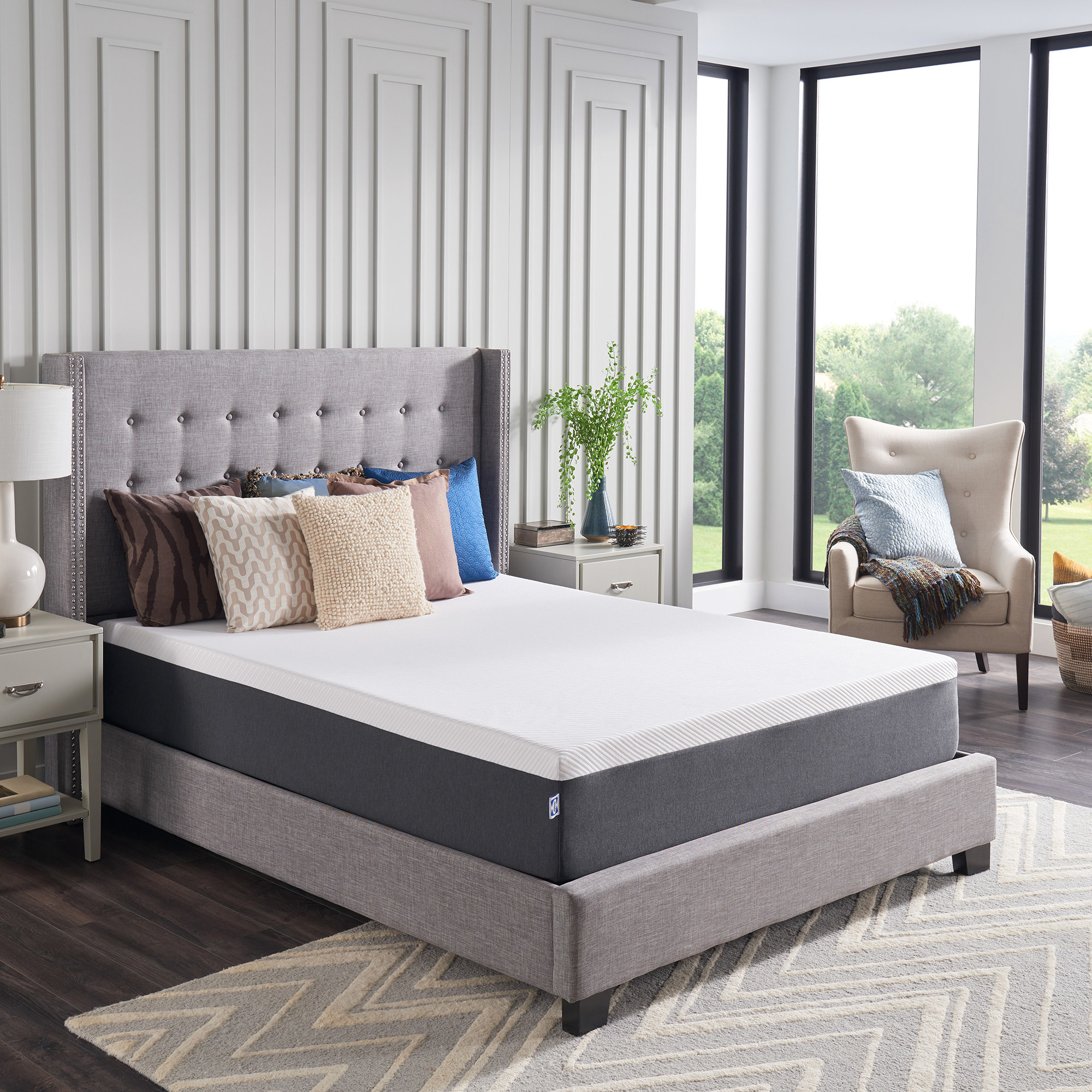 A white mattress on a grey bed