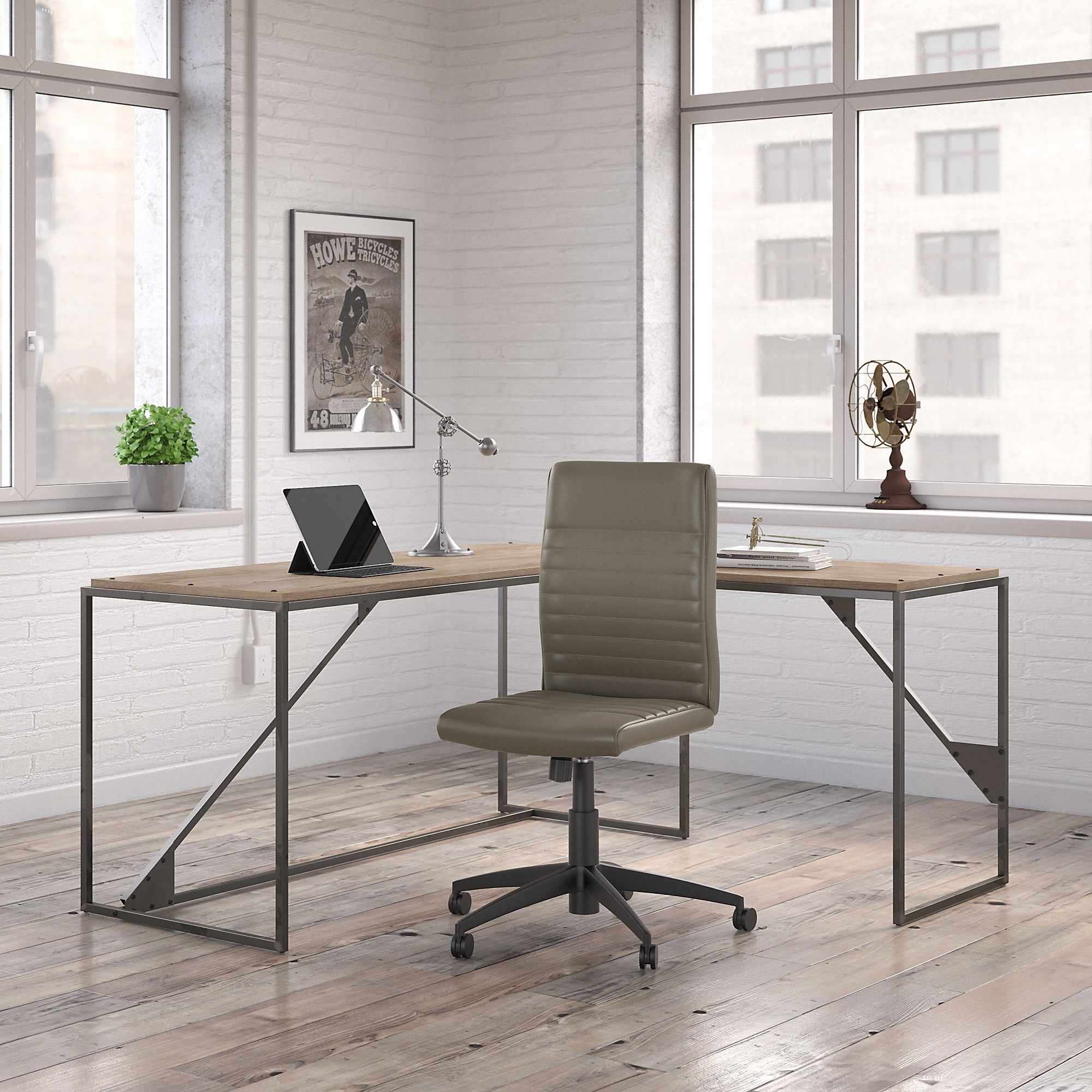 A grey/tan desk and a chair