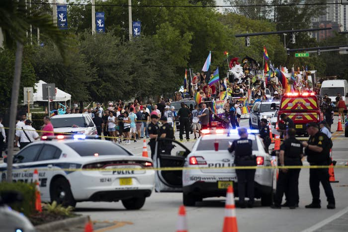 Police cars and police tape are shown amid the Pride parade