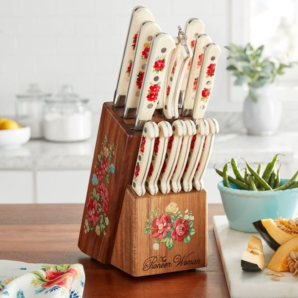 The knife set in the block, in a floral print. The knives and the block are all printed.
