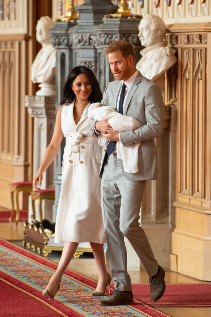 Prince Harry and Meghan Markle pose with their newborn son Archie Harrison Mountbatten-Windsor