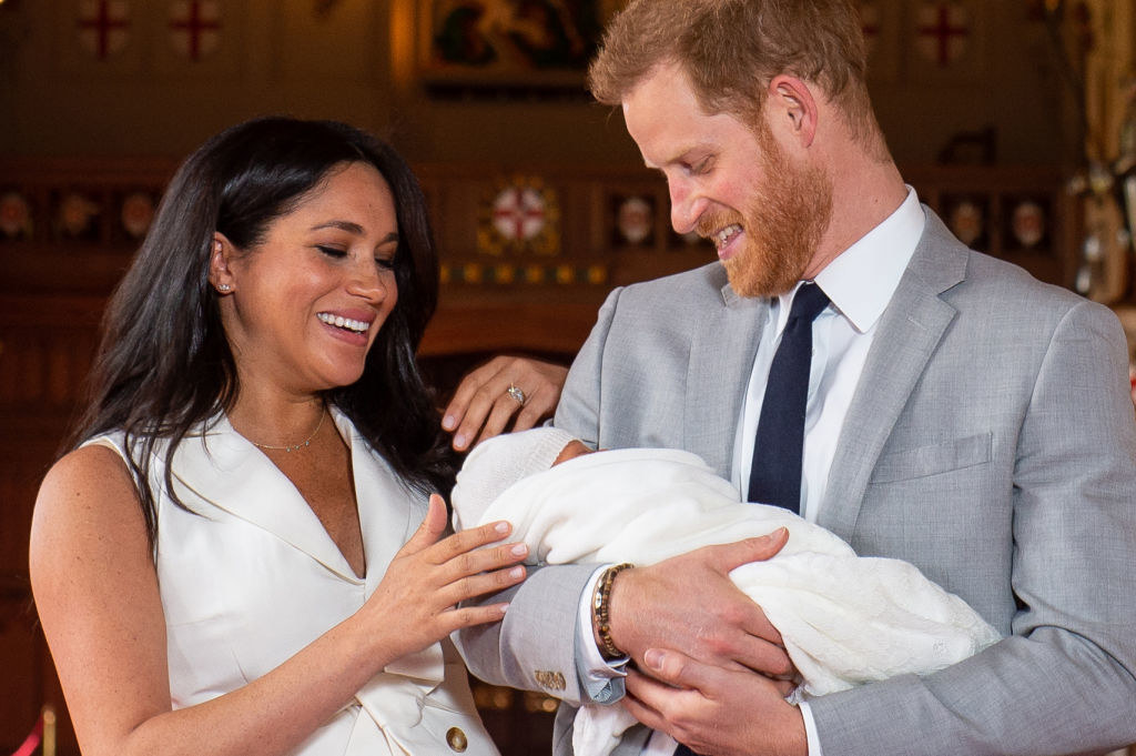 Prince Harry (R), and his wife Meghan Markle, pose for a photo with their newborn baby son, Archie Harrison Mountbatten-Windsor