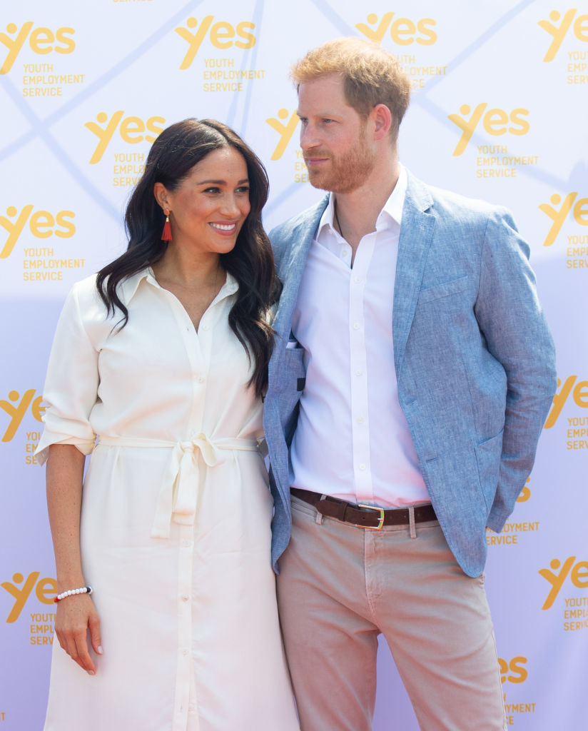 Meghan Markle (L) and Prince Harry visit the Tembisa Township to learn about Youth Employment Services