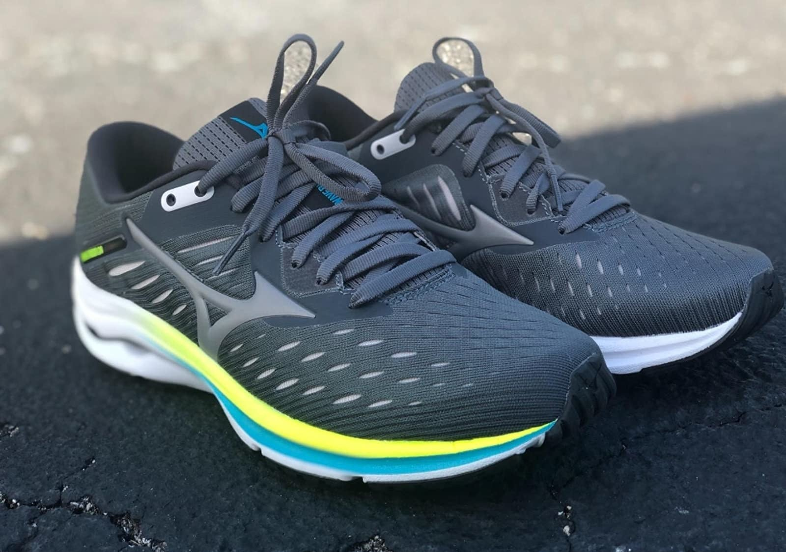a reviewer photo of the gray running sneakers