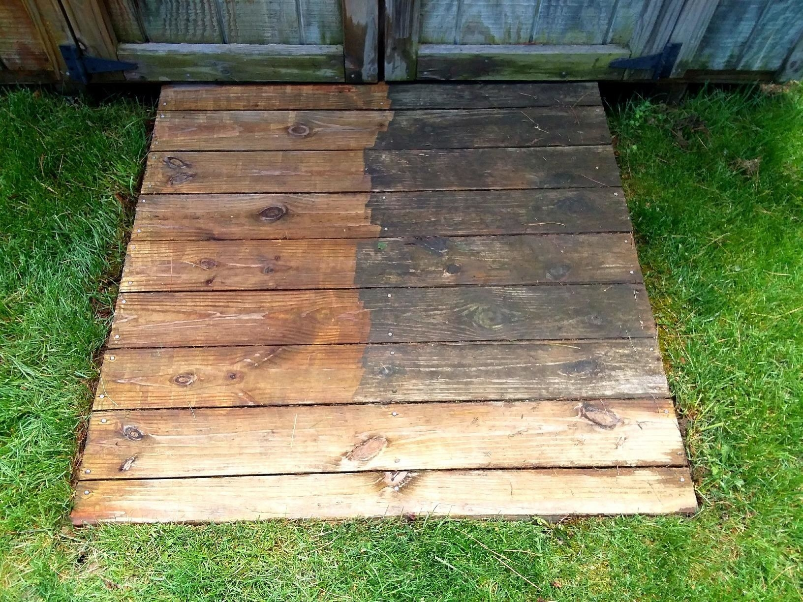 Reviewer photo of wood planks and you can clearly see where it's been cleaned with the pressure washer