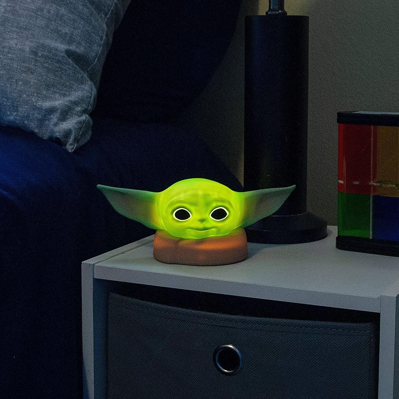 Head of Grogu illuminated on nightstand