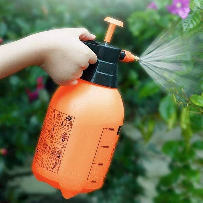 A garden water spray bottle.