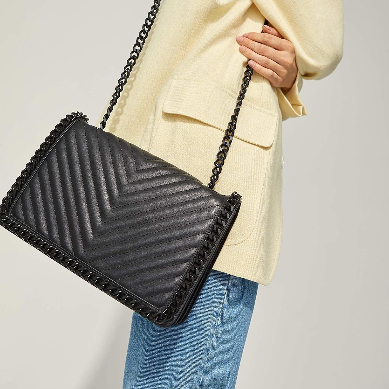 a black medium-sized crossbody bag with a black chain handle