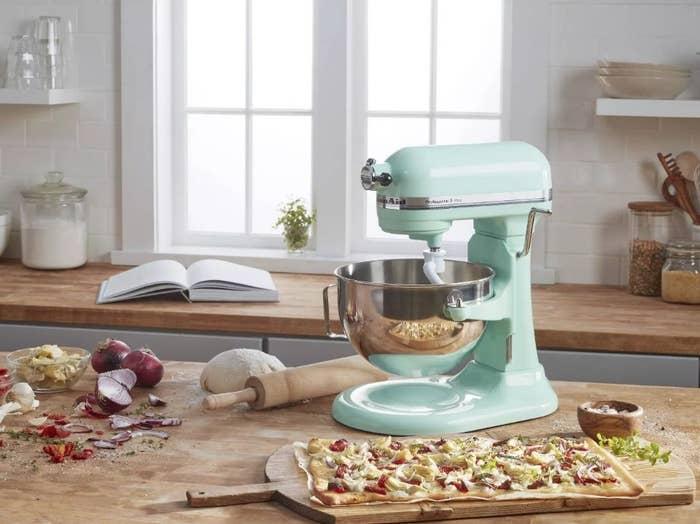 An ice blue, KitchenAid stand mixer on a kitchen island