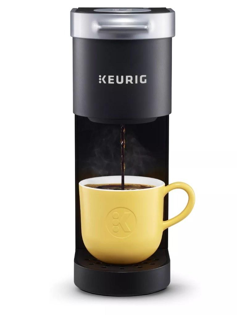 A black Keurig K-mini Single-serve K-cup Pod coffee maker brewing a cup of coffee