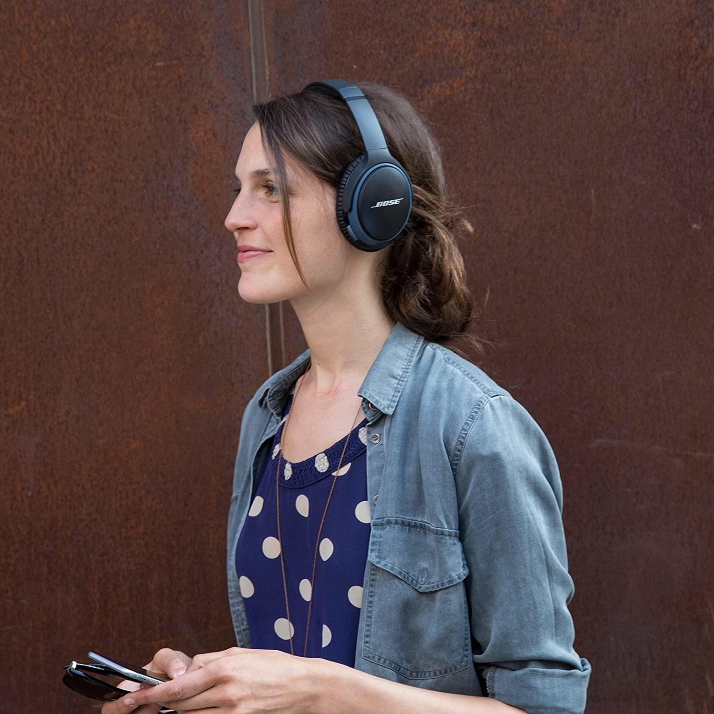Model wearing the headphones in black