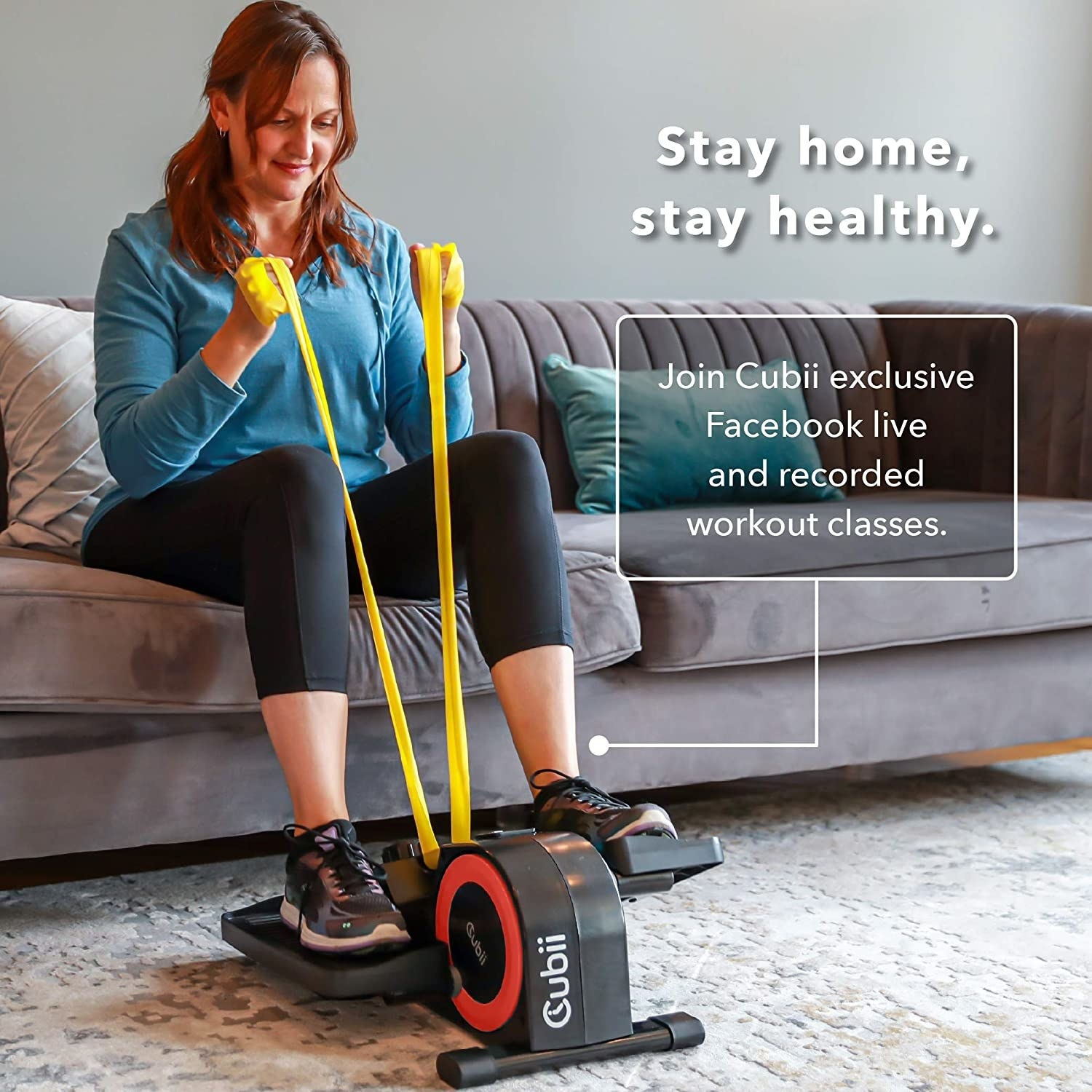 Model sitting on the couch using the bike with resistance bands