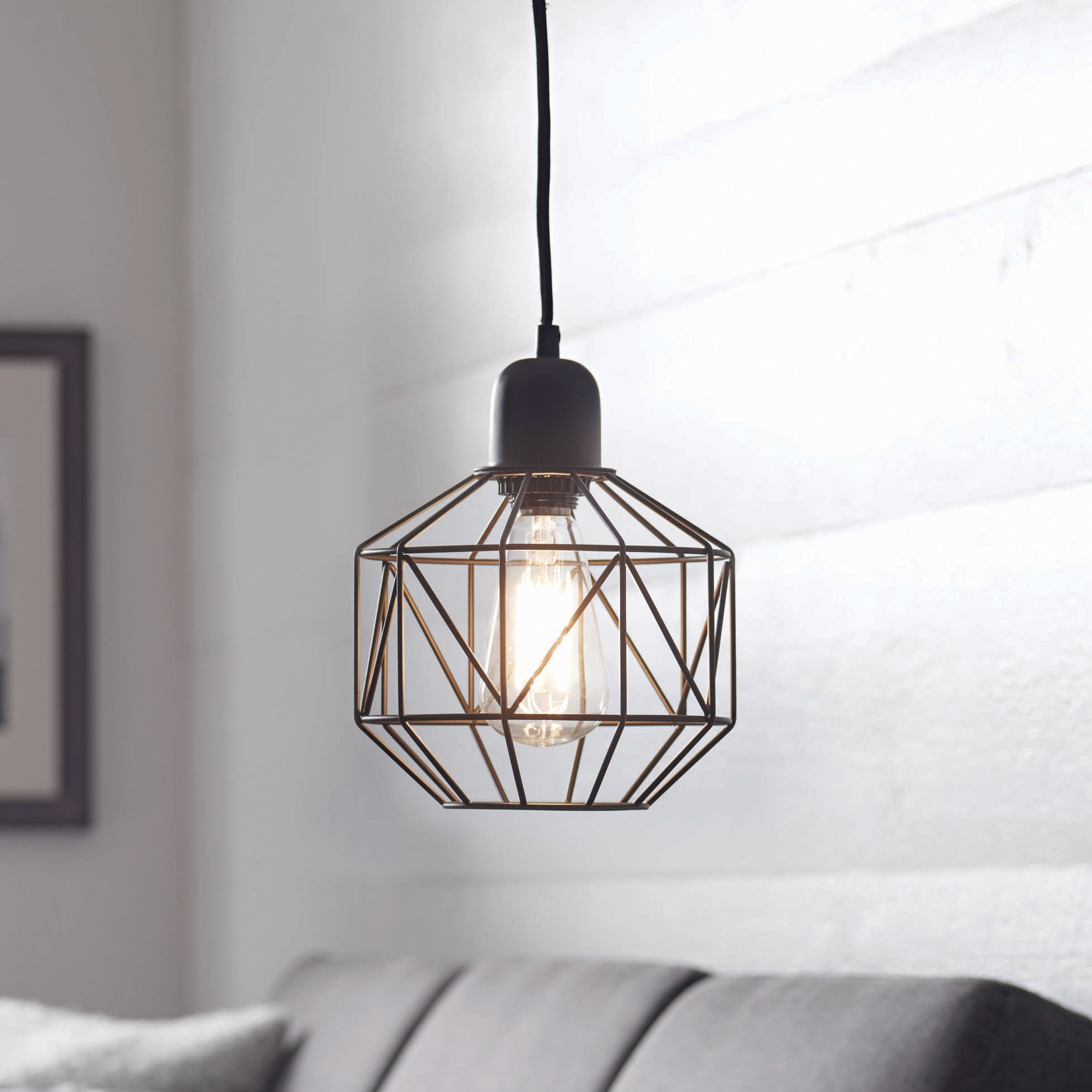 A modern light fixture hanging up