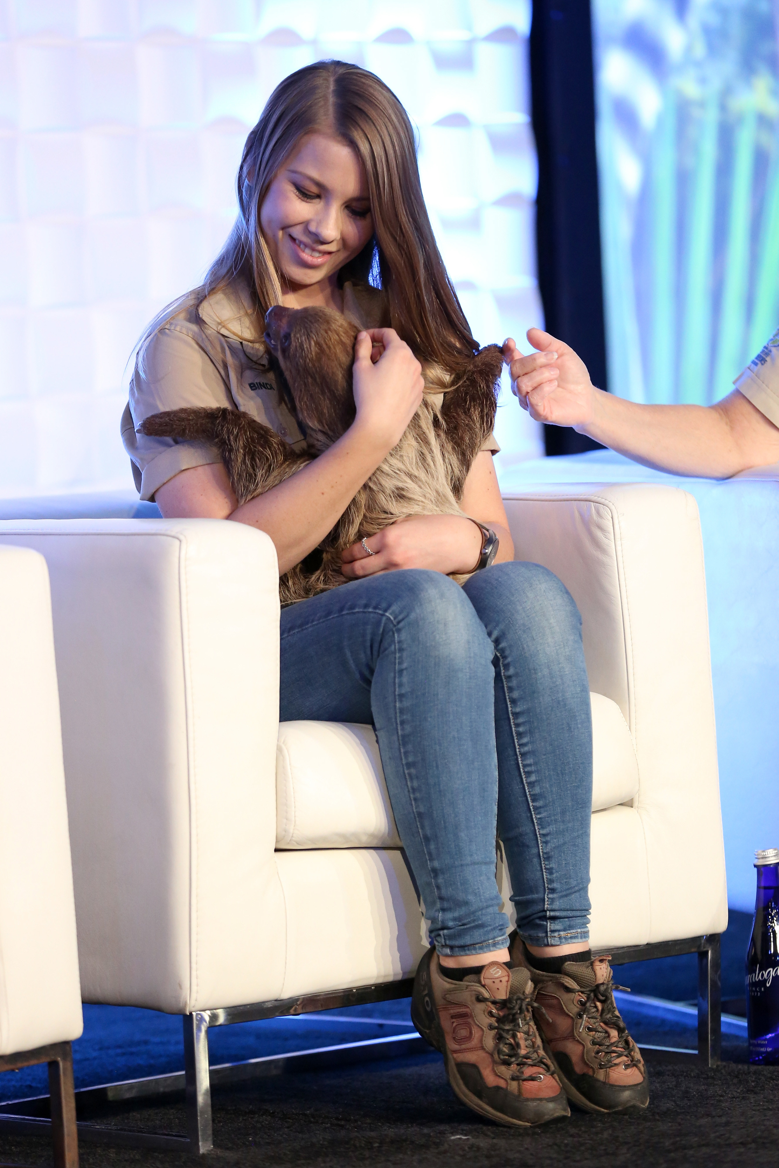 """Bindi Irwin holds a sloth onstage as Animal Planet celebrates """"Crikey! It's the Irwins"""" on October 19, 2018 in New York City"""