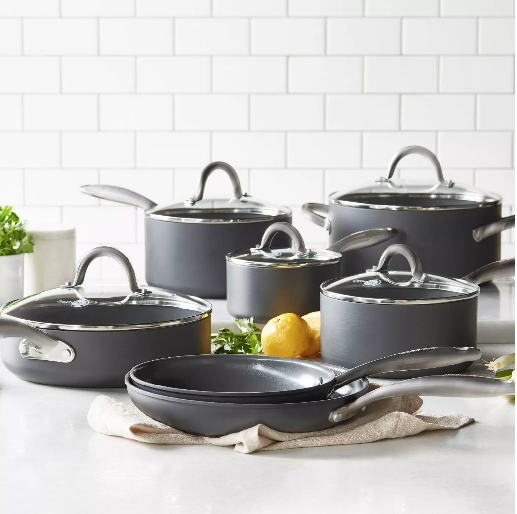 A 12-piece, non-stick, cookware set in black displayed on a kitchen counter