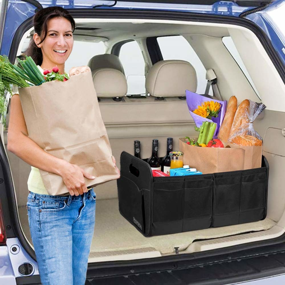 Collapsable car trunk organiser used to hold grocery items