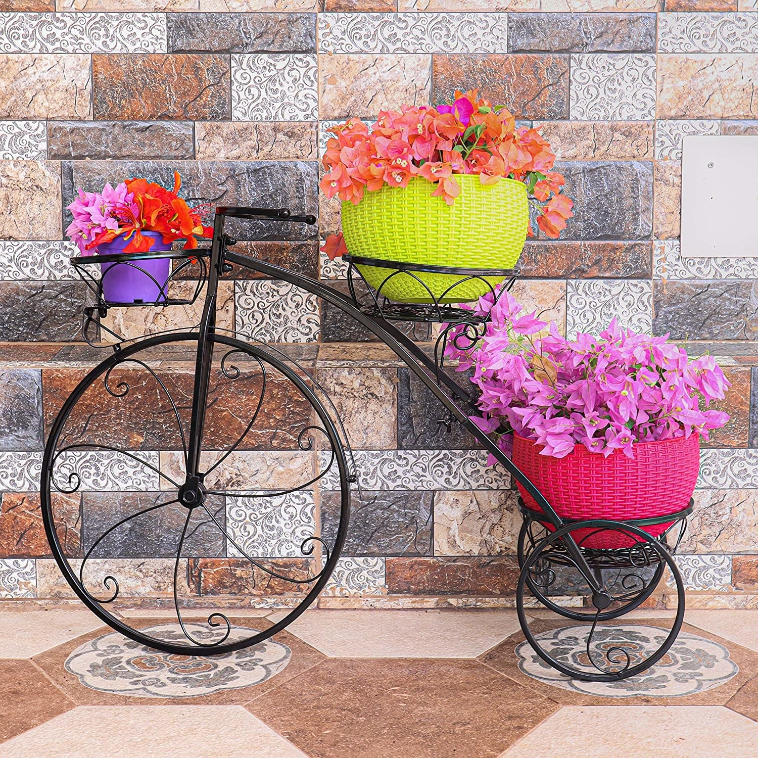 a wrought iron plant stand holding flowering planters.