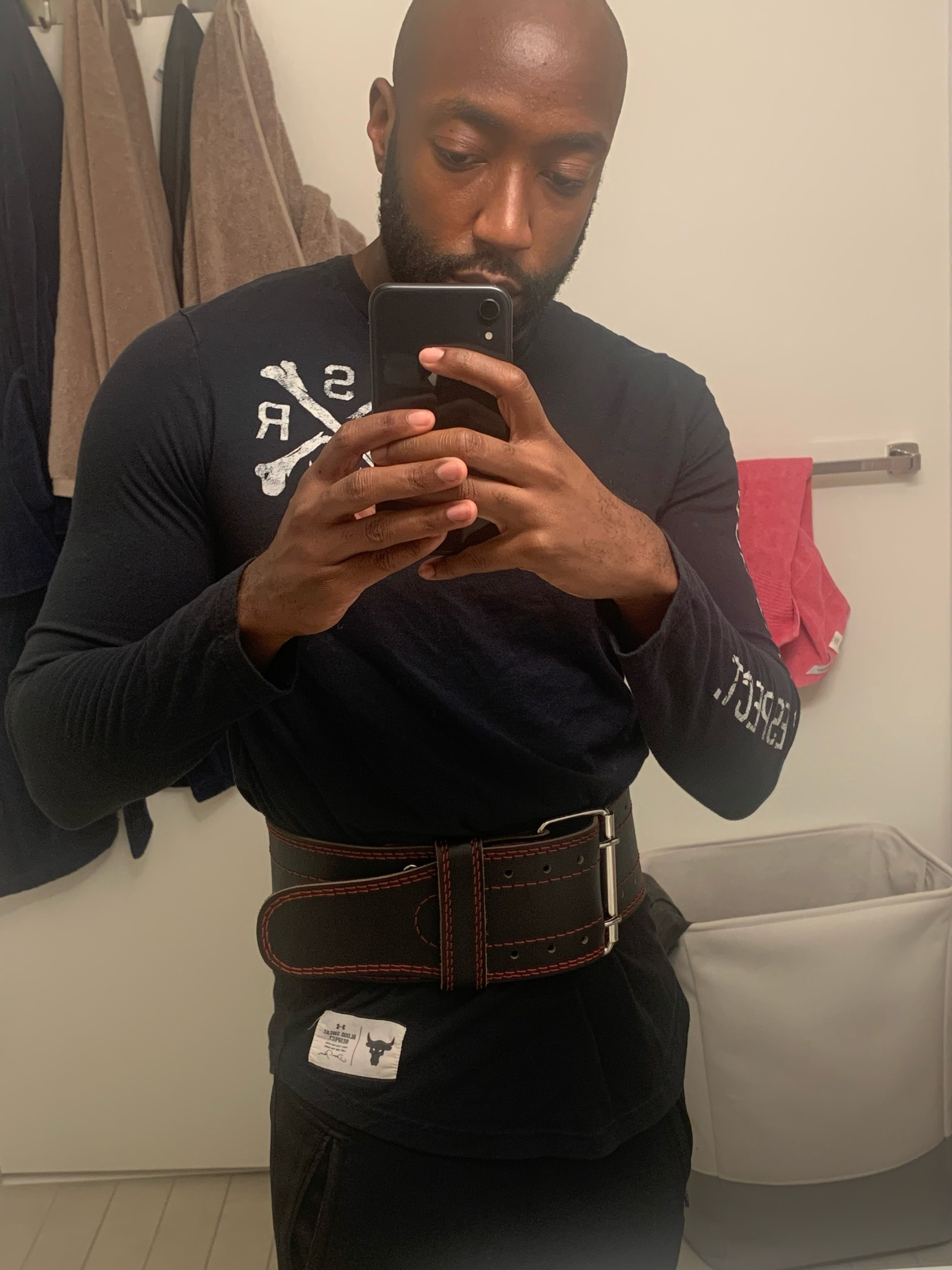 a BuzzFeed Editor wearing the weight-lifting belt