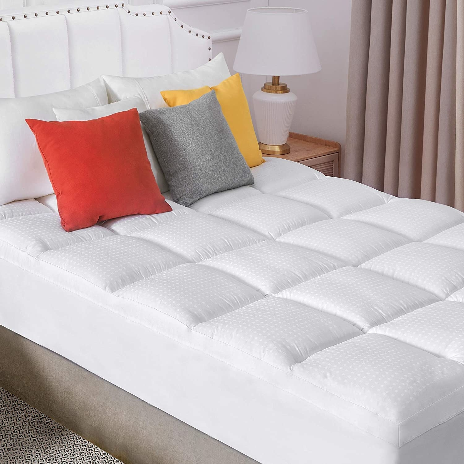 The white quilted topper