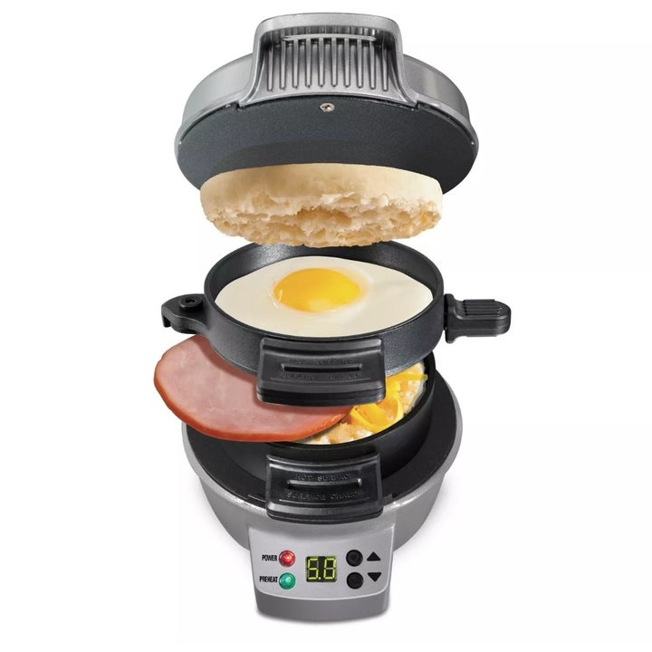 The Hamilton Beach breakfast sandwich maker being used to make an english muffin, egg, and ham sandwich